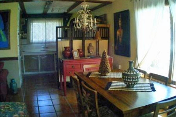 Área de estar: cocina abierta, comedor y salón